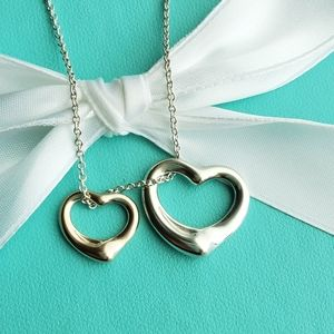 18k gold & silver open heart necklace